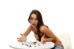 Young woman missing her coffee sitting at a table Royalty Free Stock Photos