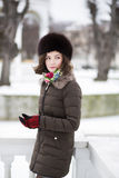 Young woman with mittens in the park Stock Photos