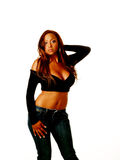 Young woman mixed ethnicity black sweater. Young woman in black sweater blue jeans bare stomach stock images