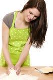 Young woman mixing dough Stock Photo