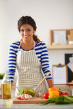 Young woman mixing fresh salad Stock Photo