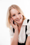 Young woman on mobile. Lovely smile stock photography