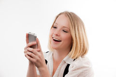 Young woman on mobile. Young woman using mobile cute smile on her face stock photography