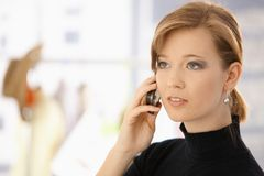 Young woman on mobile. Closeup portrait of young woman, talking on mobile phone Royalty Free Stock Photography