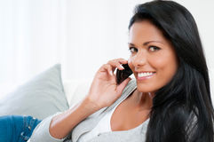 Young woman on mobile Stock Images