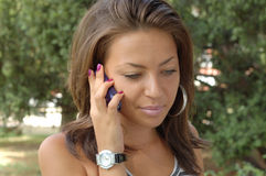 Young woman with mobile Royalty Free Stock Images