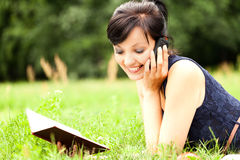 Young woman with mobile in the park Stock Photos