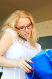 Young woman with mobile phone. Young woman with shopping bag and mobile phone Royalty Free Stock Photos