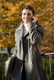Young woman on the mobile phone Stock Images
