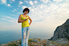 Young woman with mobile phone. On cloudscape background Stock Images