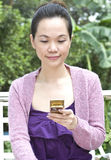 Young woman with mobile phone. Portrait of woman using mobile phone Stock Photo