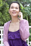 Young woman with mobile phone. Portrait of woman using mobile phone Stock Images