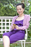 Young woman with mobile phone. Portrait of woman using mobile phone Stock Photography