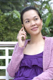 Young woman with mobile phone. Portrait of woman using mobile phone Royalty Free Stock Photo