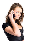 Young woman with mobile phone. Isolated on white Royalty Free Stock Photography
