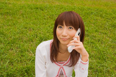 Young woman with mobile phone. Young Asian woman talking with mobile phone Stock Photo