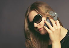 Young woman with a mobile phone Stock Photos