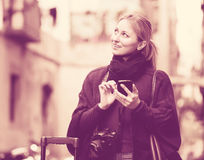 Young woman with mobile phone outdoors Royalty Free Stock Images