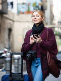 Young woman with mobile phone outdoors Stock Photo