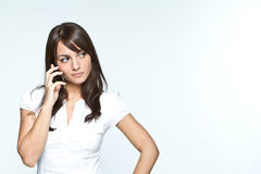 Young woman with mobilephone. Young woman in studio with mobilephone Stock Photo