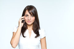 Young woman with mobilephone. Young woman in studio with mobilephone Stock Image