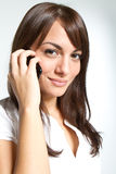 Young woman with mobilephone. Young woman in studio with mobilephone Royalty Free Stock Images