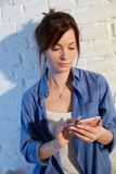 Young woman with mobilephone. Young woman using mobilephone, portrait Royalty Free Stock Images