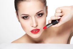 Young woman model with glamour red lips Stock Photos