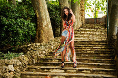 Young Woman, Model Of Fashion, In A Garden Stairs Royalty Free Stock Photo
