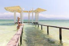 Young woman model posing bikini inside sea. Royalty Free Stock Image