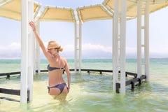 Young woman model posing bikini inside sea. Stock Photo
