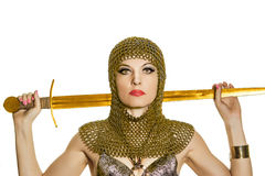 Young woman model in viking armor with sword Stock Images