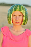 young woman model with water-melon on head Stock Photography