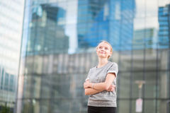 Young woman in modern glass office interior Royalty Free Stock Images