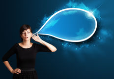 Young woman with modern speech bubble Stock Photo
