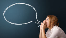 Young woman with modern speech bubble Royalty Free Stock Image
