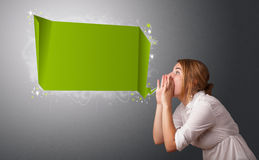 Young woman with modern speech bubble. And copy space Royalty Free Stock Photography