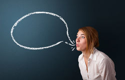 Young woman with modern speech bubble Royalty Free Stock Photo