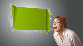 Young woman with modern speech bubble. And copy space Royalty Free Stock Images
