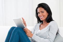 Young woman with modern tablet Stock Photo