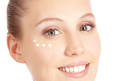 Young woman with moisturizer Stock Photo