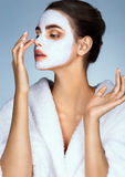 Young woman with moisturizing facial mask Royalty Free Stock Images