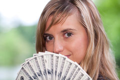 Young woman with money. Royalty Free Stock Photo