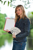 Young woman with money and clipboard. Stock Photos