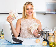 Young woman with money in hands Royalty Free Stock Photo