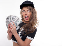 Young woman  with money in her hands emotion studio portrait on Royalty Free Stock Photos
