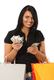 Young woman with money and shopping bags Stock Photos