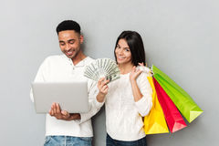 Young woman with money standing near man Stock Image