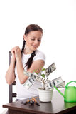 Young woman with money tree. Stock Photos