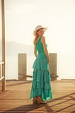 Young woman at the moorage. Young woman in blue dress standing at the moorage Royalty Free Stock Images